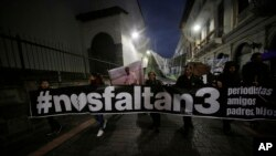 "Relatives of the El Comercio journalists, who were kidnapped on the Ecuador-Colombia border 11 days ago, carry a banner reading in Spanish ""We lack 3"" and walk to government palace to demand more action by government to secure their release in Quito, Ecuador, April 5, 2018."