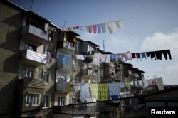 FILE - Laundry is seen hung out to dry in Nagorno-Karabakh's main city of Stepanakert, April 8, 2016.