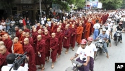 Buddhist monks stage a rally to protest against ethnic minority Rohingya Muslims, Mandalay, Burma, September 2, 2012.