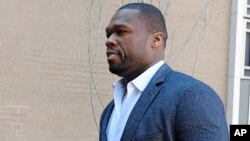 "Curtis ""50 Cent"" Jackson arrives at court for a federal bankruptcy hearing, March 9, 2016, in Hartford, Conn."