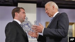 Vice President of the United States Joe Biden, right, speaks to Russian President Dmitry Medvedev during their meeting at the Gorky presidential residence outside Moscow, March 9, 2011