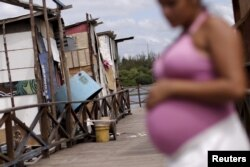 Lediane da Silva, who is eight months pregnant, is seen in the shanty town of Beco do Sururu, Recife, Brazil, Jan. 29, 2016.