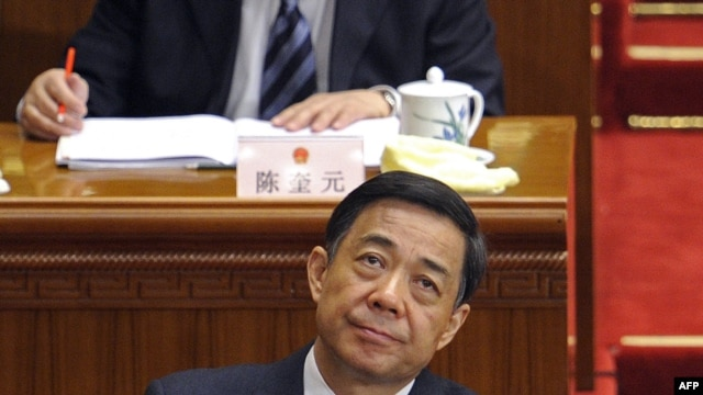 In a file picture taken on March 5, 2012, Chongqing mayor Bo Xilai (bottom C) attends the opening session of the National People's Congress (NPC) at the Great Hall of the People in Beijing.
