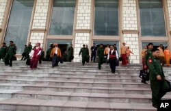 Lawmakers of the National League for Democracy party (NLD) and Military representatives leave the parliament after attending a regular session of the Union Parliament, August 25, 2016, in Naypyitaw, Myanmar.