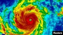 Super Typhoon Soudelor is seen in an enhanced infrared NOAA satellite image taken in the Western Pacific Ocean at 08:32 ET (12:32 GMT) August 4, 2015.