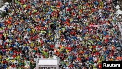 FILE - Runners fill the street at the start of the Tokyo Marathon, Feb. 2014.