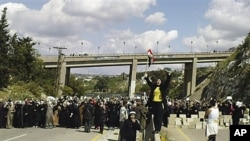 Women hold an anti-government demonstration in Banias, Syria, April 13, 2011