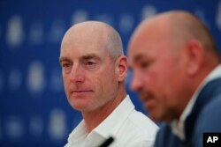 USA captain Jim Furyk, left, and Europe Captain Thomas Bjorn speak during a news conference ahead of the Ryder Cup at the Golf National in Guyancourt, outside Paris, France, Sept. 24, 2018.