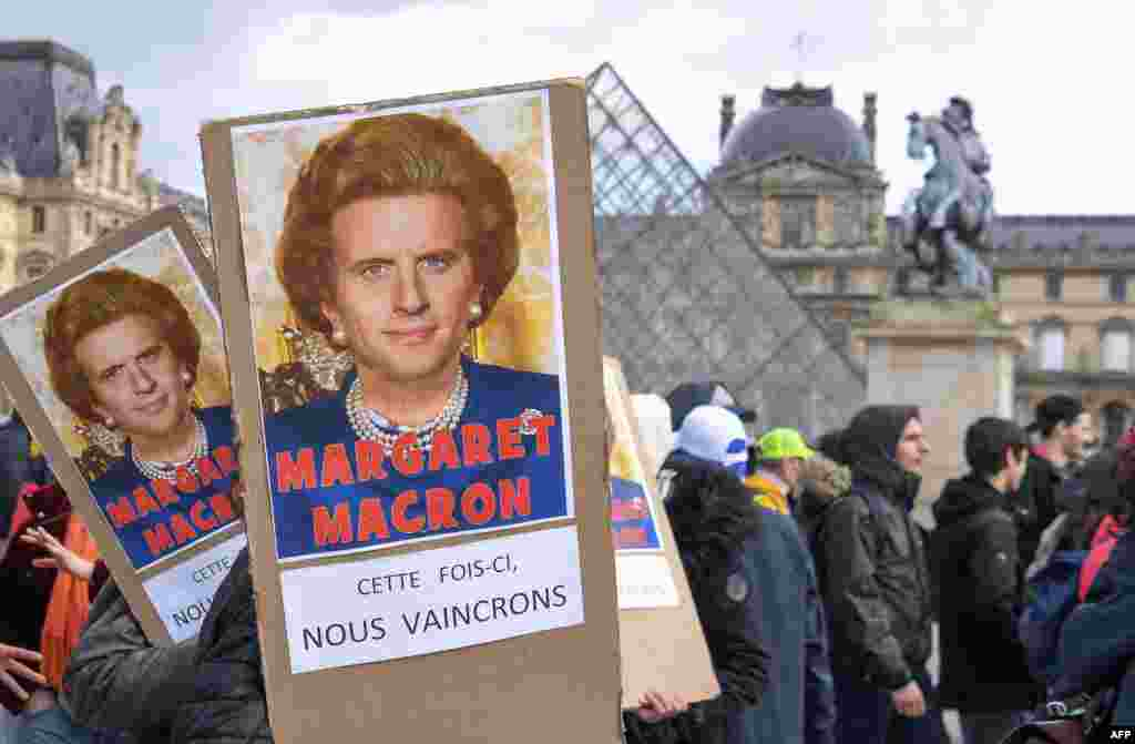 "Protesters hold placards reading ""Maragaret Macron, this time we will win"" under a photomontage of late British Prime Minister Margaret Thatcher and French President Emmanuel Macron as they demonstrate in front of the Louvre Museum in Paris as part of a multi-sector strike against the French government's pensions overhaul."