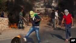 소년의 죽음에 항의하는 팔레스타인 시위대