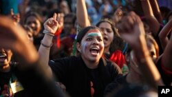 """Indian women shout slogans during an event to support the """"One Billion Rising"""" global campaign in Hyderabad, India, Feb. 14, 2013."""