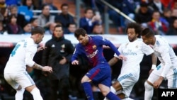 "Barcelona's Argentinian forward Lionel Messi (C) vies with Real Madrid's Spanish defender Sergio Ramos, Real Madrid's Brazilian defender Marcelo and Real Madrid's Brazilian midfielder Casemiro during the Spanish League ""Clasico"" football match Real Madrid"