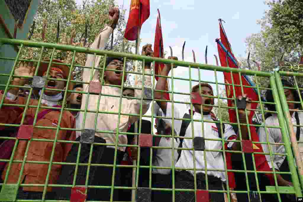 Student protesters shout inside a monastery compound after police surrounded the monastery apparently to prevent them from proceeding with a march to Yangon from Letpadan, north of Yangon, Myanmar, to protest against an academic law.