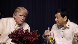 U.S. President Donald Trump talks with Philippines President Rodrigo Duterte during the gala dinner marking ASEAN's 50th anniversary in Manila, Philippines, Nov. 12, 2017.