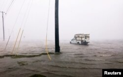 A truck is seen stuck in flood waters as Hurricane Harvey comes ashore in Corpus Christi, Texas, Aug. 25, 2017.