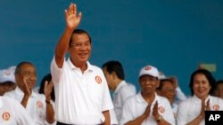 Cambodian Prime Minister Hun Sen waves to supporters during his Cambodian People's Party's campaign in Phnom Penh, Cambodia, Saturday, July 7, 2018. The official campaigning period for July 29 general election began with Hun Sen's ruling party virtually a