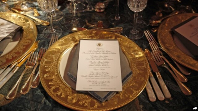 A table setting for the state dinner hosted by U.S. President Barack Obama for Chinese President Hu Jintao is shown at the White House, 19 Jan 2011.