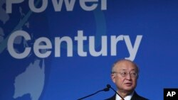 FILE - In this Oct. 30, 2017, photo, Yukiya Amano, the head of the International Atomic Energy Agency, speaks at a United Nations conference in Abu Dhabi. The U.N. agency monitoring Iran's compliance with a landmark nuclear treaty issued a report Nov. 13,
