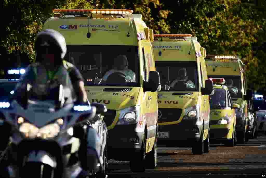 An ambulance transporting Miguel Pajares, a Spanish priest who was infected with the Ebola virus while working in Liberia, leaves the Military Air Base of Torrejon de Ardoz, near Madrid, Spain, Aug. 7, 2014.