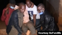 FILE: MDC activists carrying Harare West Member of Parliament Joanna Mamombe after she was abducted, tortured and dumped by unknown assailants in Bindura. (Courtesy Image: MDC)