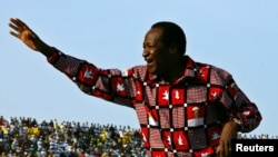 FILE - Burkina Faso President Blaise Compaore waves to supporters at the end of his re-election campaign in Ouagadougou, Nov. 11, 2005.