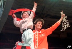 FILE - Tennessee coach Pat Summitt and son, Tyler, take down the net after Tennessee defeated Georgia, 83-65, in the title game at the NCAA women's basketball Final Four at Charlotte Coliseum in Charlotte, North Carolina, March 31, 1996