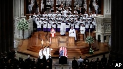The choir sings at a memorial service for Sen. John McCain, at Washington National Cathedral in Washington, Sept. 1, 2018.