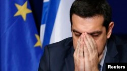FILE - Greece's Prime Minister Alexis Tsipras addresses a news conference in Brussels, February 12, 2015.