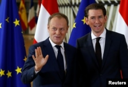 European Council President Donald Tusk poses with Austria's Chancellor Sebastian Kurz ahead of a meeting in Brussels, Belgium, Dec. 19, 2017.