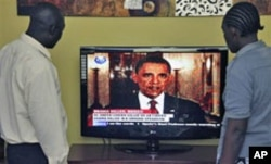 Kenyans in Nairobi watch President Obama announce the death of bin Laden.