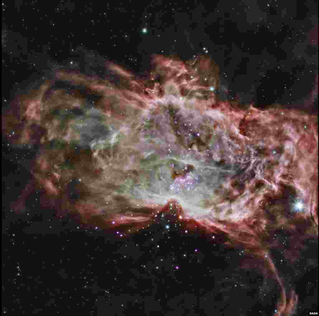 This composite image shows one of the clusters, NGC 2024, which is found in the center of the so-called Flame Nebula about 1,400 light years from Earth. In this image, X-rays from Chandra are seen as purple, while infrared data from NASA's Spitzer Space Telescope are colored red, green, and blue. Astronomers have studied two star clusters and the results show that the simplest ideas for the birth of these clusters cannot work.