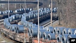 Steel coils sit on wagons when leaving the thyssenkrupp steel factory in Duisburg, Germany, March 2, 2018.