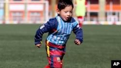 Murtaza Ahmadi, a five-year-old Afghan Lionel Messi fan, plays football at the Afghan Football Federation Stadium in Kabul, Afghanistan, Tuesday, Feb. 2, 2016.