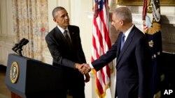 Presidente Barack Obama y fiscal general de EE.UU. Eric Holder, el 25 de septiembre, cuando Holder anunció su renuncia.