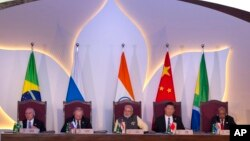 Leaders of BRICS nations, from left, Brazilian President Michel Temer, Russian President Vladimir Putin, Indian Prime Minister Narendra Modi, Chinese President Xi Jinping and South African President Jacob Zuma listen to the BRICS Business Council report d