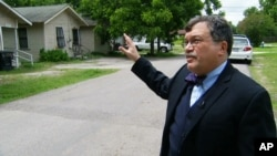 FILE - Dr. Peter Hotez, dean of the Baylor College of Tropical Medicine, shows Associated Press journalists areas of Houston's 5th Ward that may be at high risk for mosquitoes capable of transmitting the Zika virus in Houston.