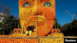 A worker puts the final touches to a Beijing opera mask made with lemons and oranges. This was part of the 82th Lemon festival in Menton, France 2015. (Photo REUTERS/Eric Gaillard)