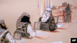 In this pool photo of a sketch by courtroom artist Janet Hamlin and reviewed by the U.S. Department of Defense, three of the five Sept. 11 defendants, from left, Ramzi Binalshibh, Walid bin Attash and the self-proclaimed terrorist mastermind Khalid Sheikh Mohammed, attend a hearing at the Guantanamo Bay U.S. Naval Base in Cuba, Jan. 28, 2013.