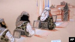 In this pool photo of a sketch by courtroom artist Janet Hamlin and reviewed by the U.S. Department of Defense, three of the five Sept. 11 defendants, from left, Ramzi Binalshibh, Walid bin Attash and the self-proclaimed terrorist mastermind Khalid Sheikh