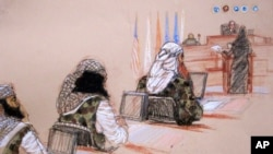 FILE - Sketch of five Sept. 11 defendants, back row from left, Mustafa Ahmad al-Hawsawi, Ammar al Baluchi, Ramzi Binalshibh, Walid bin Attash and the self-proclaimed terrorist mastermind Khalid Sheikh Mohammed, attend a hearing on pretrial motions in their death penalty case at the Guantanamo Bay U.S. Naval Base in Cuba.