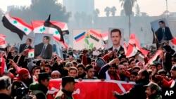 Los partidarios del gobierno apoyan al presidente sirio Bashar Assad.