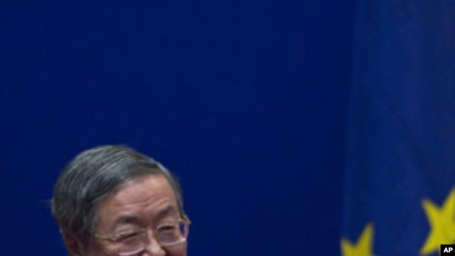 China's Central Bank Governor Zhou Xiaochuan reacts after European Commission President Jose Manuel Barroso gave a speech on the euro at the University of International Business and Economics in Beijing, China, Feb. 15, 2012.