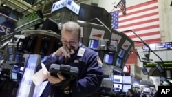 You can often tell from their faces if traders working the floor of the New York Stock Exchange are in the black or in the red. (AP Photo/Richard Drew, 2010)
