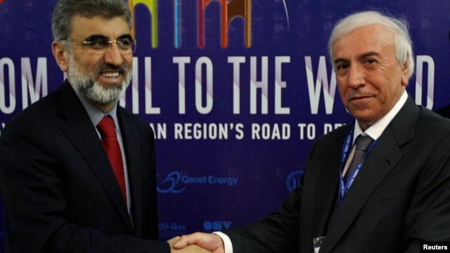 FILE - Kurdistan Regional Government Natural Resources Minister Ashti Hawrami, right, shakes hands with Turkey's Energy Minister Taner Yildiz, Irbil, Iraq, May 2012.