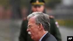 U.S. National Security Adviser John Bolton attends a wreath laying ceremony at the Tomb of the Unknown Soldier by the Kremlin wall in Moscow, Russia, Tuesday, Oct. 23, 2018. U.S. President Donald Trump's national security adviser Bolton struck a conciliatory note Tuesday in talks in Moscow, just days after Trump vowed to pull out of a key arms control treaty with Russia. (Kirill Kudryavtsev/Pool Photo via AP)