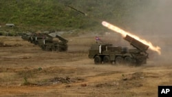 Cambodian army multiple rocket launchers are test fired at Phnom Sruoch complex of Cambodian army base, in Kampong Speu province, some 65 kilometers (40 miles) southwest of Phnom Penh, Cambodia, Tuesday, April 2, 2013. About 107 rounds of Russian-made BM-21 rockets were fired, according to the army. (AP photo/Heng Sinith)