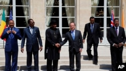 French President Francois Hollande, third right, shakes hands with Nigeria President Goodluck Jonathan, third left, as others, from left, Niger's President Mahamadou Issoufou, Chad's President Idriss Debi, Cameroon President Paul Biya, Benin president Tho