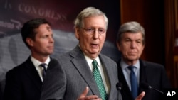 Senate Majority Leader Mitch McConnell of Ky., center, speaks during a news conference on Capitol Hill in Washington, March 6, 2019.