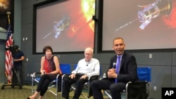 Astrophysicist Eugene Parker sits between Johns Hopkins University project scientist Nicola Fox, left, and NASA's science mission chief Thomas Zurbuchen, during a news conference about the Parker Solar Probe at the Kennedy Space Center in Florida, Aug. 9,