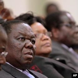 Zimbabwe's Prime Minister Morgan Tsvangirai (L) attends a session at Parliament in Harare (File)